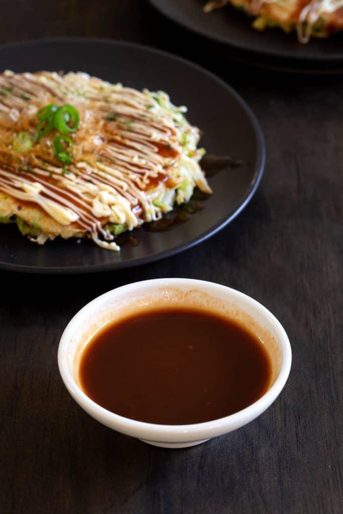 White dish with Japanese pancake sauce.