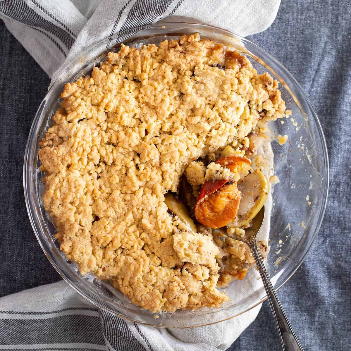Persimmon crumble in a glass baking dish.
