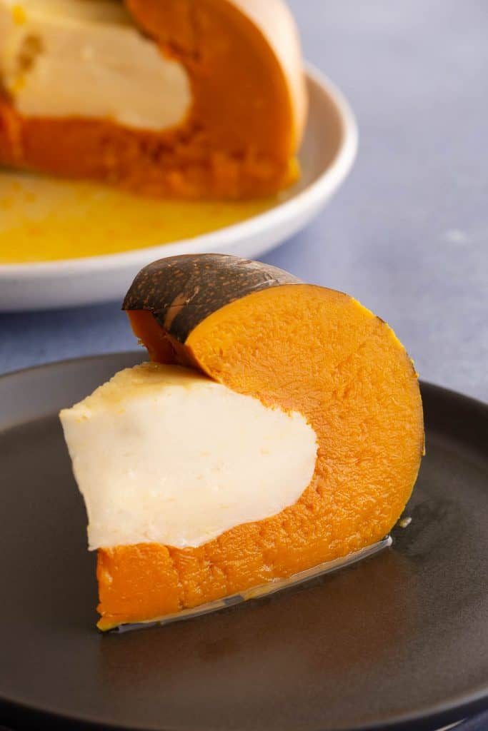 Slice of pumpkin with coconut custard in the middle.