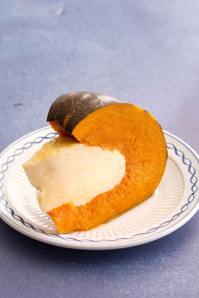 Single slice of coconut custard stuffed pumpkin.