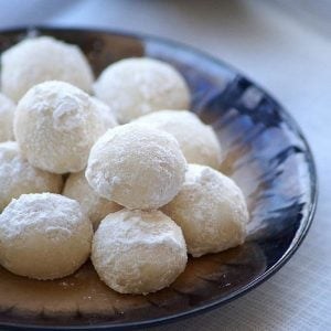 A plate of white snowball cookies perfect for Christmas!