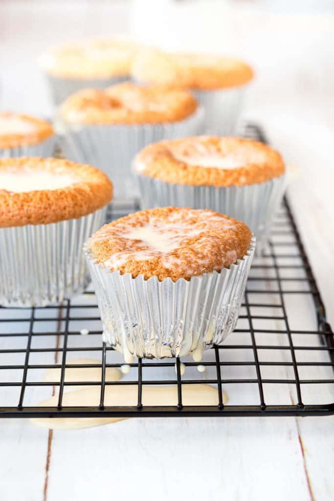 Cupcakes on a tray, soaking up three milk syrup.