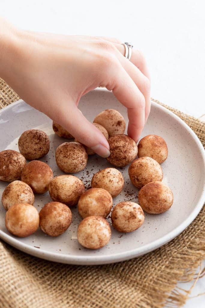 Plate of sweet coconut balls ready to eat.