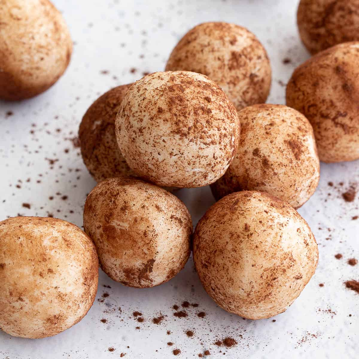 Cocoa coconut balls on a white background.