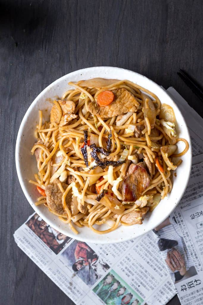 Top down of yakisoba noodles in a white bowl.