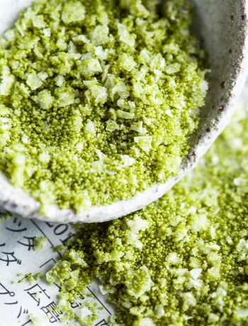 Close up shot of matcha seasoned salt showing the texture of the salt flakes.