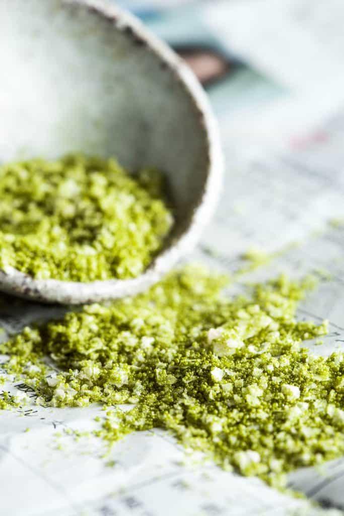 A close up shot of matcha seasoned salt.