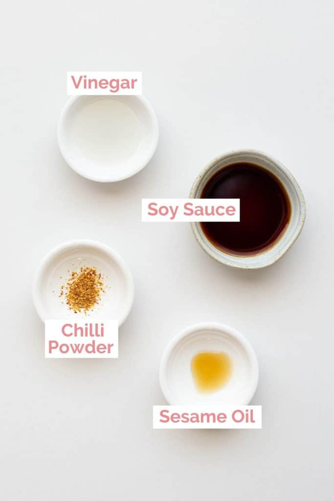 Four ingredients laid out for gyoza sauce.