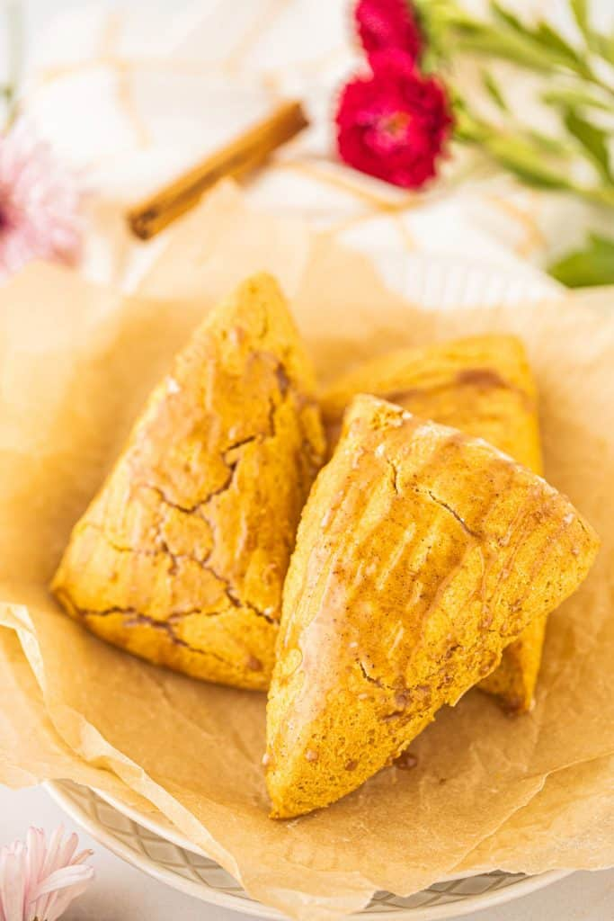 Gluten free pumpkin scones on a plate made by the Clean Eating Kitchen.