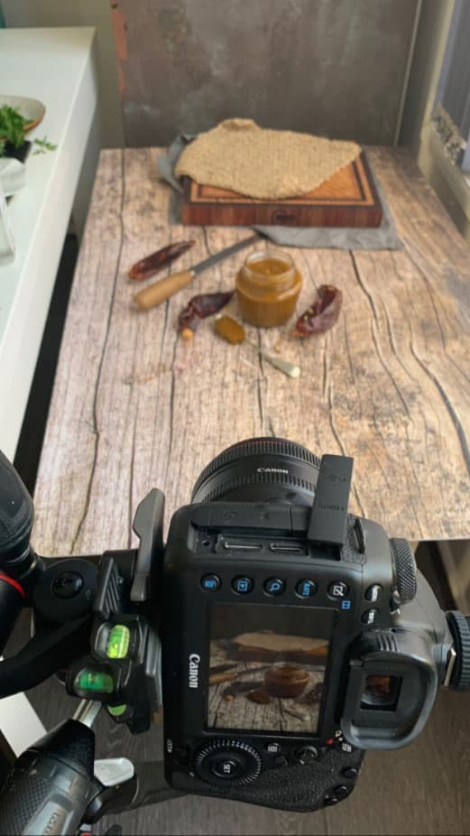 Shooting a food photography scene with a camera on a tripod.