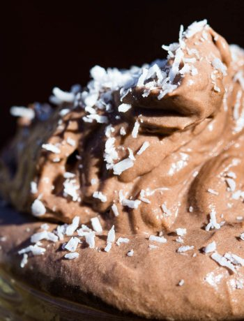 Close up shot of fluffy chocolate mousse garnished with desiccated coconut.