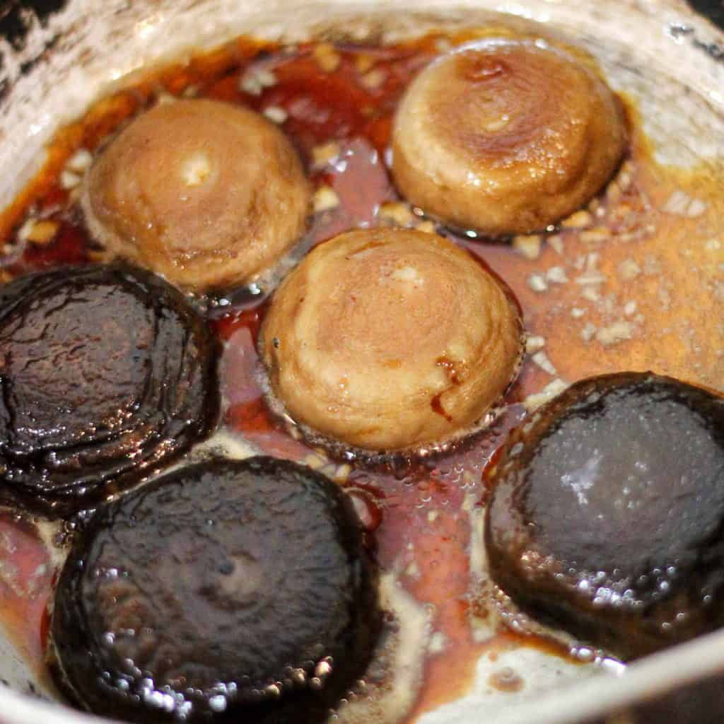 Mushrooms slow cooking in vegan friendly soy sauce marinade.