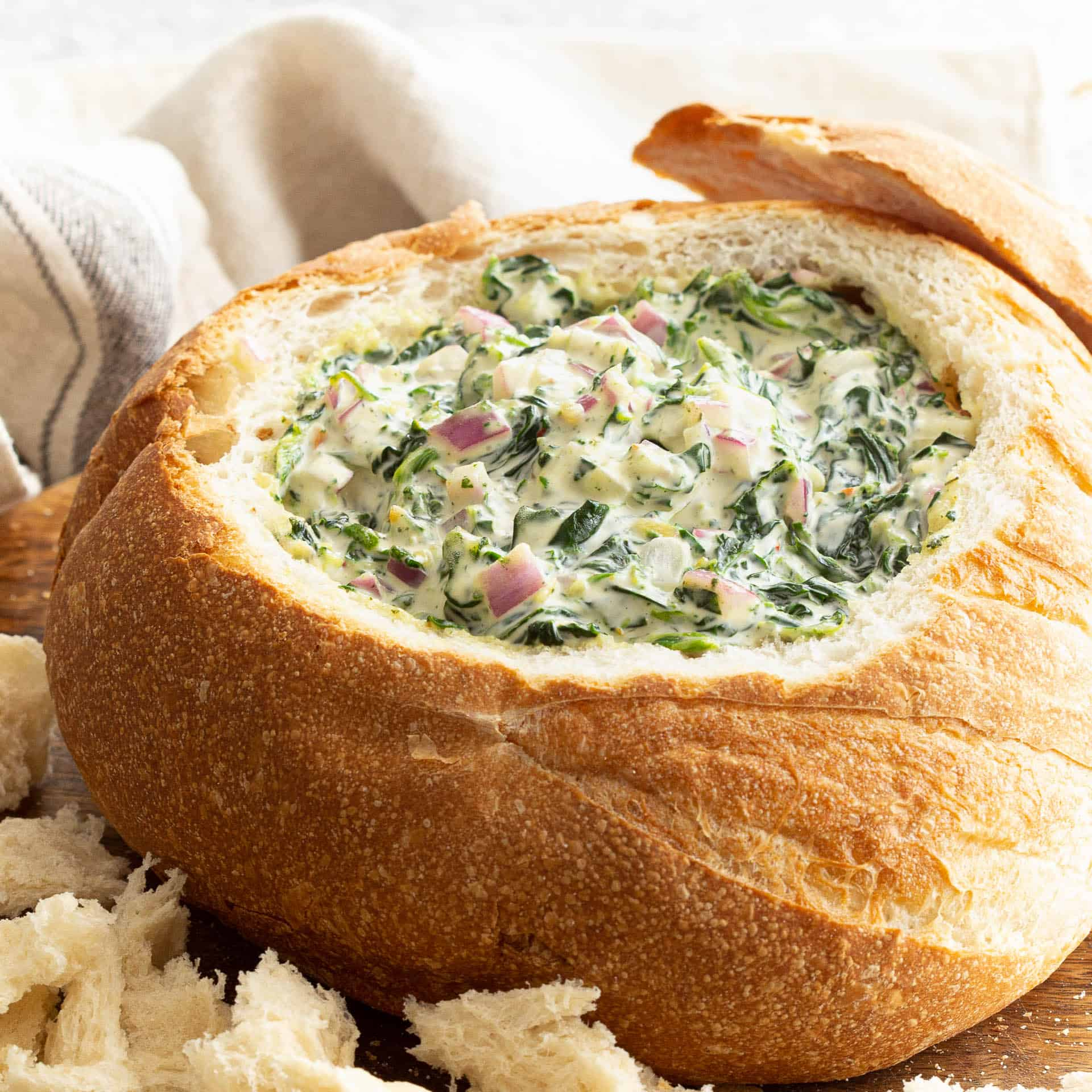 Spinach Cob Loaf with top crust removed.