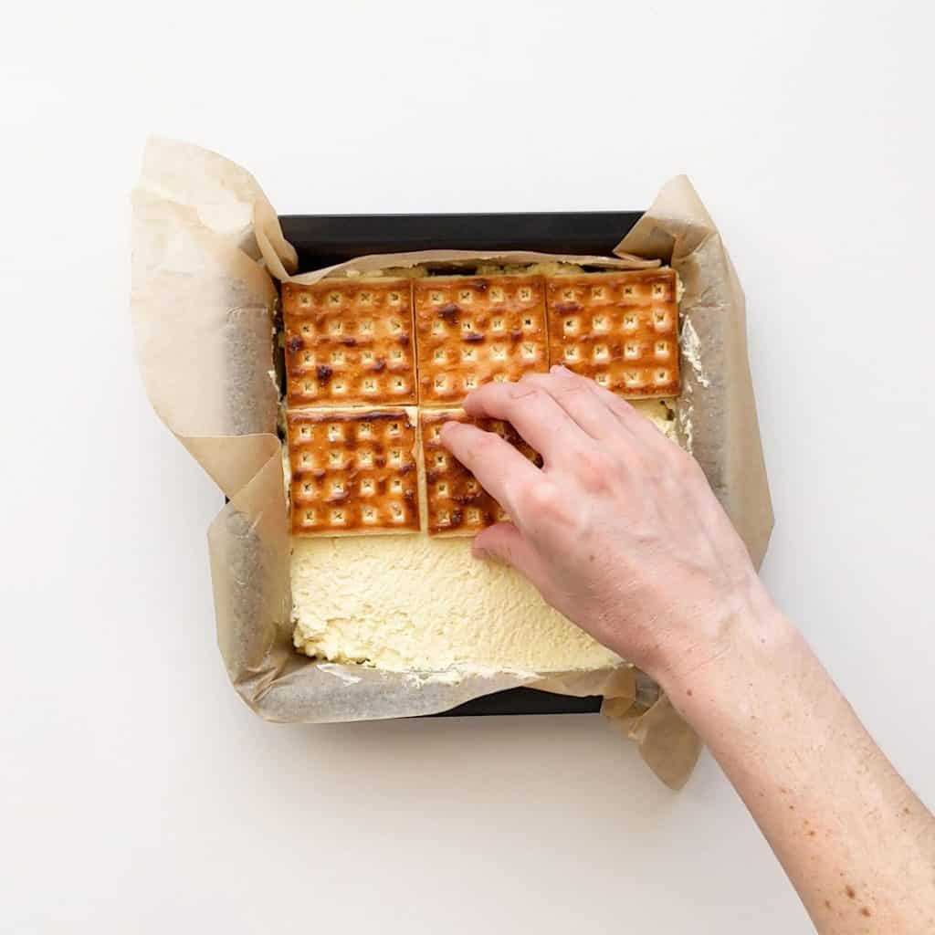 Pressing out the top layer of lattice biscuits.