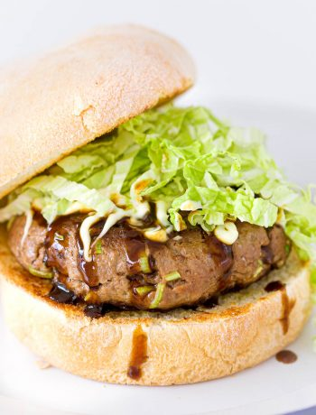 A Japanese style burger on a white plate.