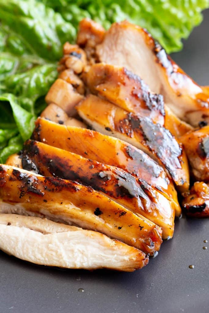 Shiny glaze on sliced teriyaki chicken.