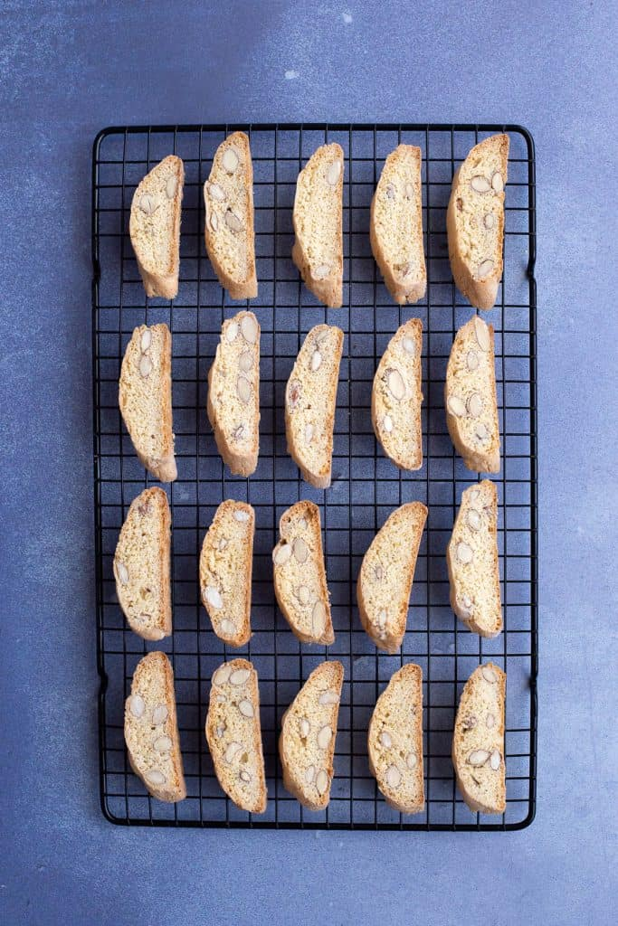 Italian almond biscotti laid out on a cooling rack.