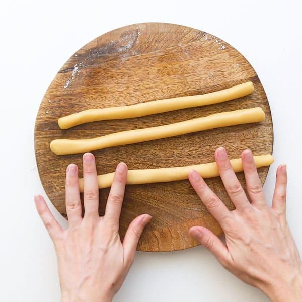 Making three thin dough ropes.
