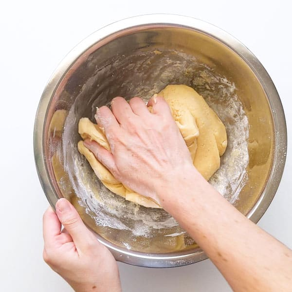 Kneading the dough together.