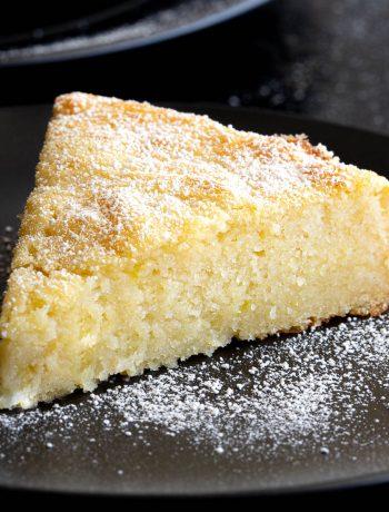 Slice of lemon ricotta cake on plate.
