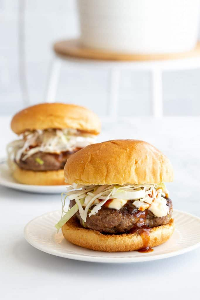 Two Japanese style hamburgers ready to eat.
