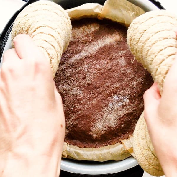 Lifting chocolate concrete cake out the Ninja Foodi.
