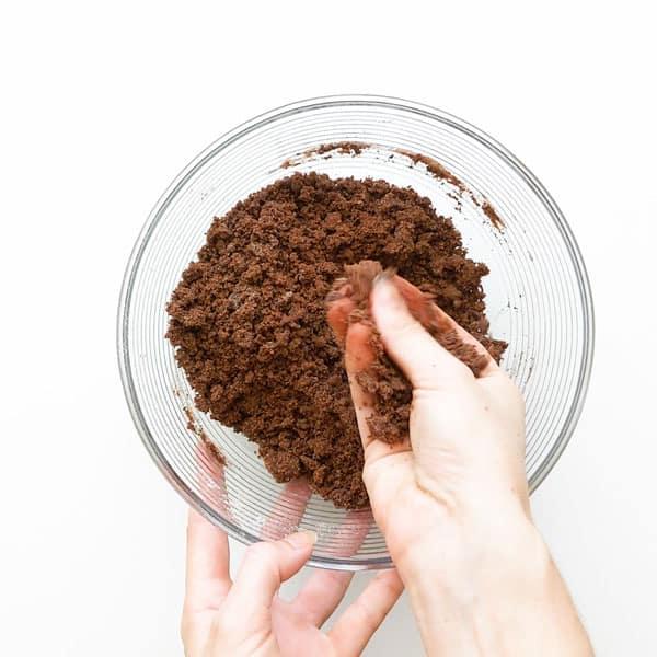 Showing chocolate concrete mix texture, similar to potting soil.