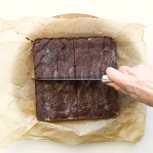 Slicing chocolate concrete into squares.