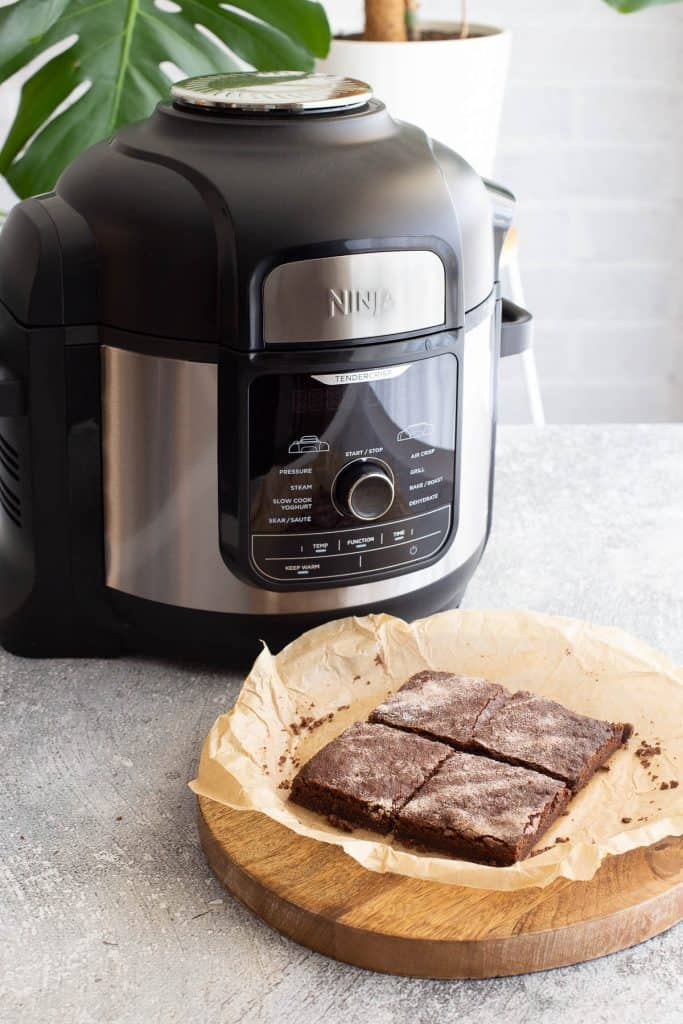 Freshly baked chocolate concrete with Ninja Foodi Max Multicooker in background.