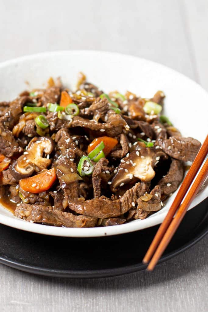 A plate of stir fried beef and vegetables cooked in Korean BBQ sauce.