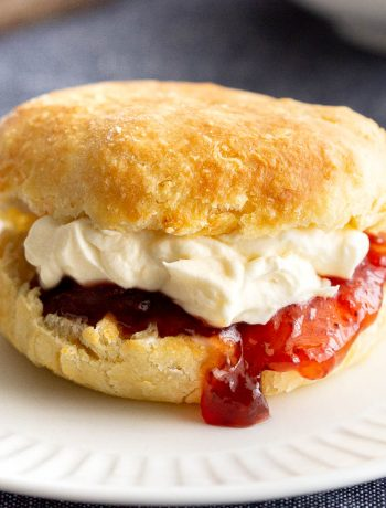 Jam and cream filled plain scone with crispy outside texture.