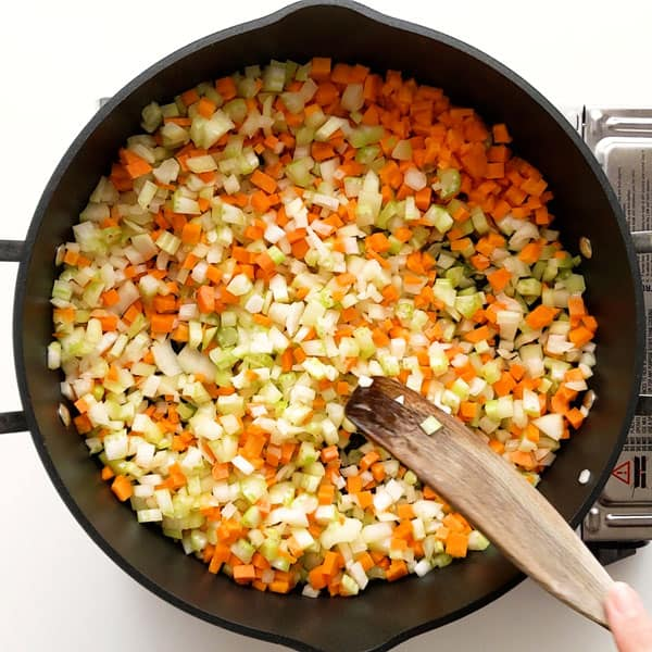 Making the soffritto (sauteed onion, celery and carrot).