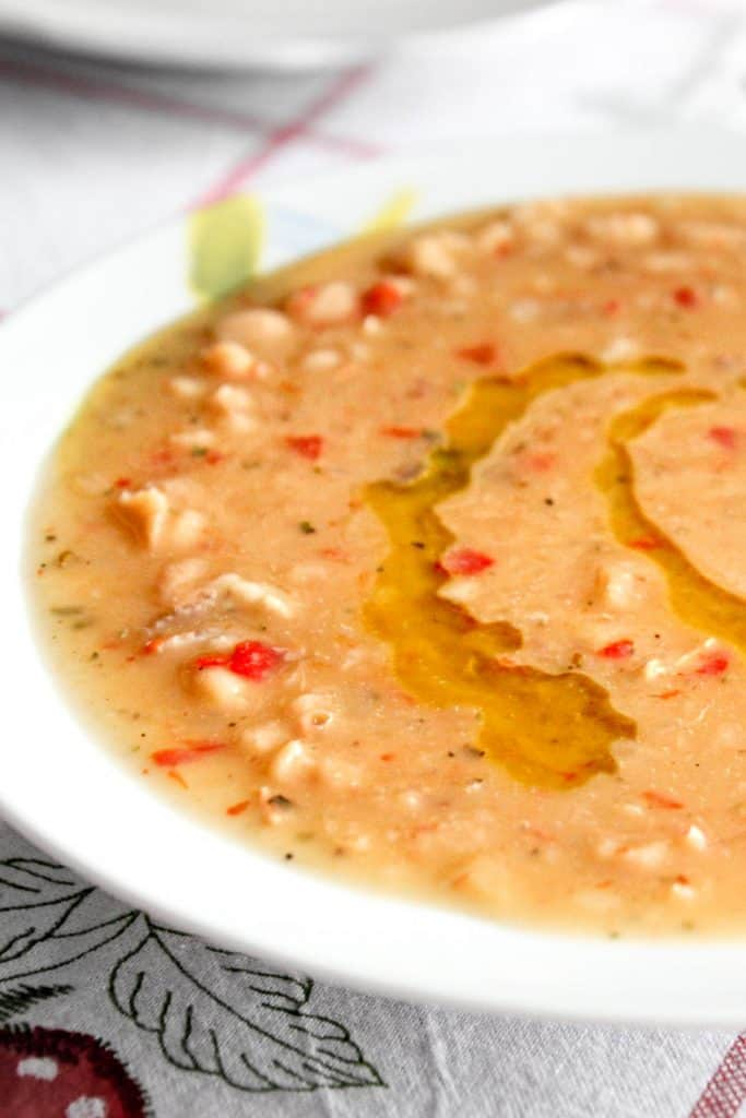 Close up of white bean soup with olive oil.