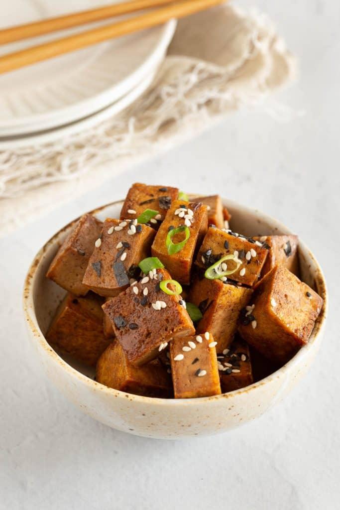 A bowl of stir fried teriyaki tofu.