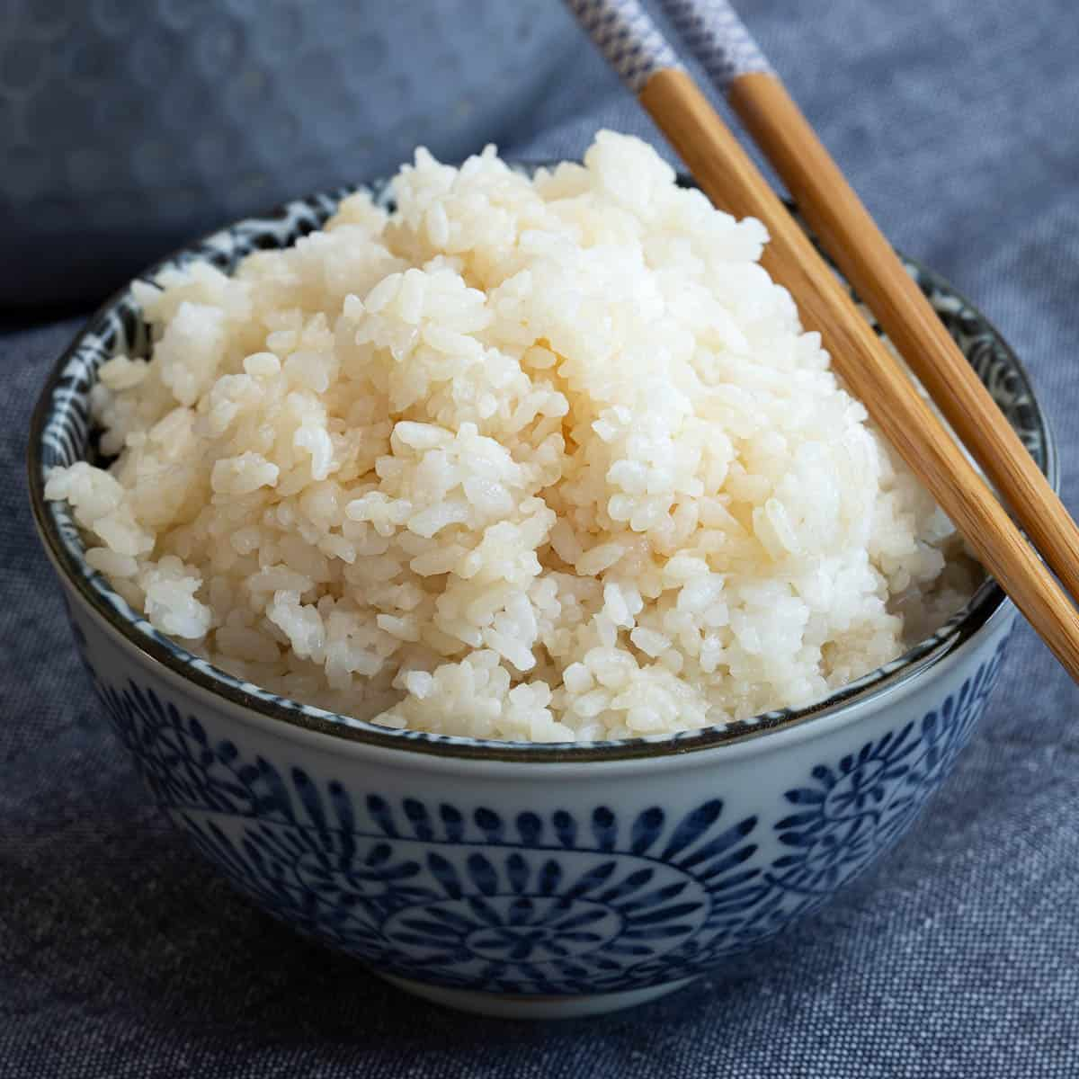 Bowl of fluffy white sushi rice made in the instant pot.