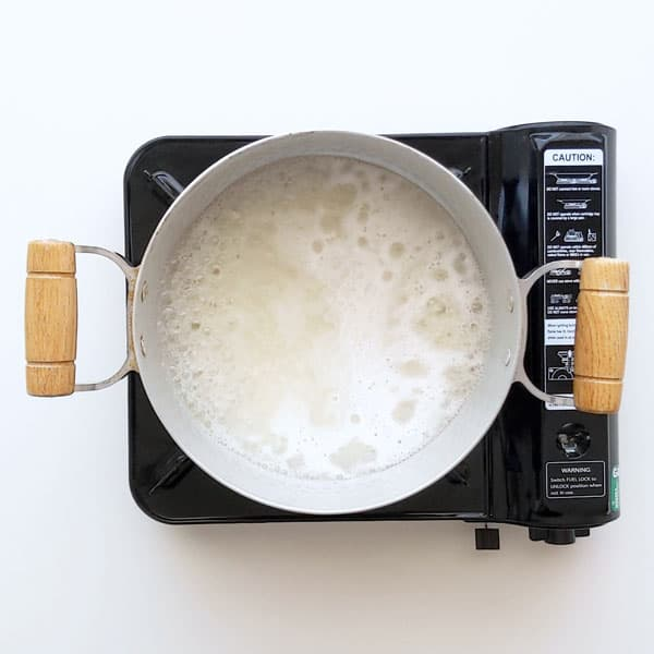 Bringing the sushi rice to a boil for the stovetop method.