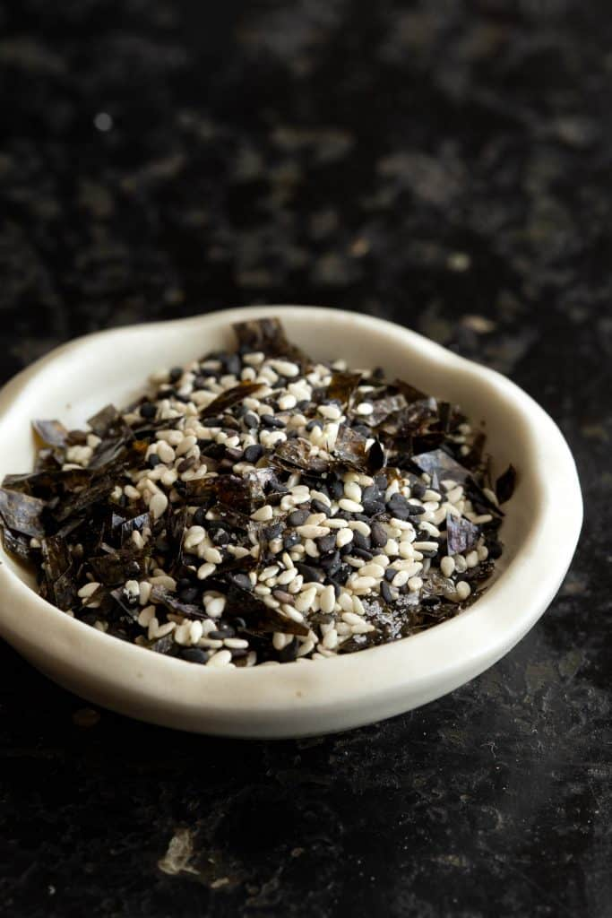 A small bowl of furikake showing the black and white sesame seeds.