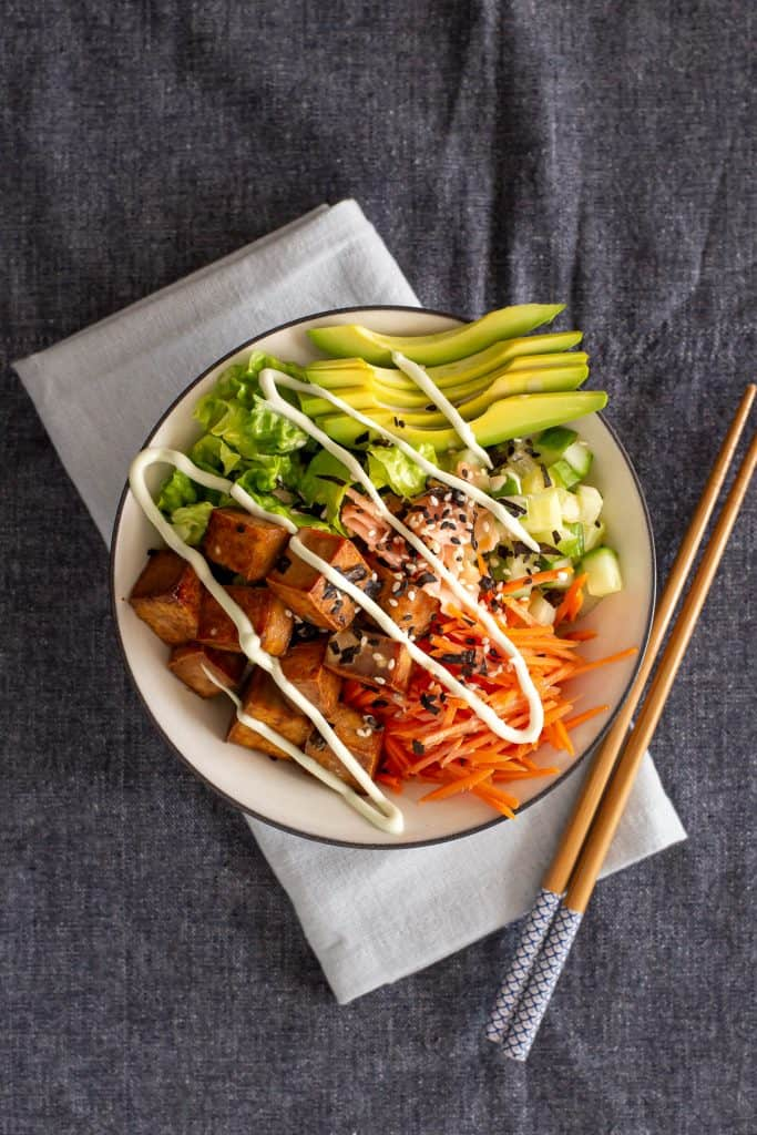 Top down view of a sushi bowl drizzled with sesame mayo.