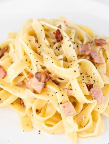 Close up shot of finished carbonara pasta.