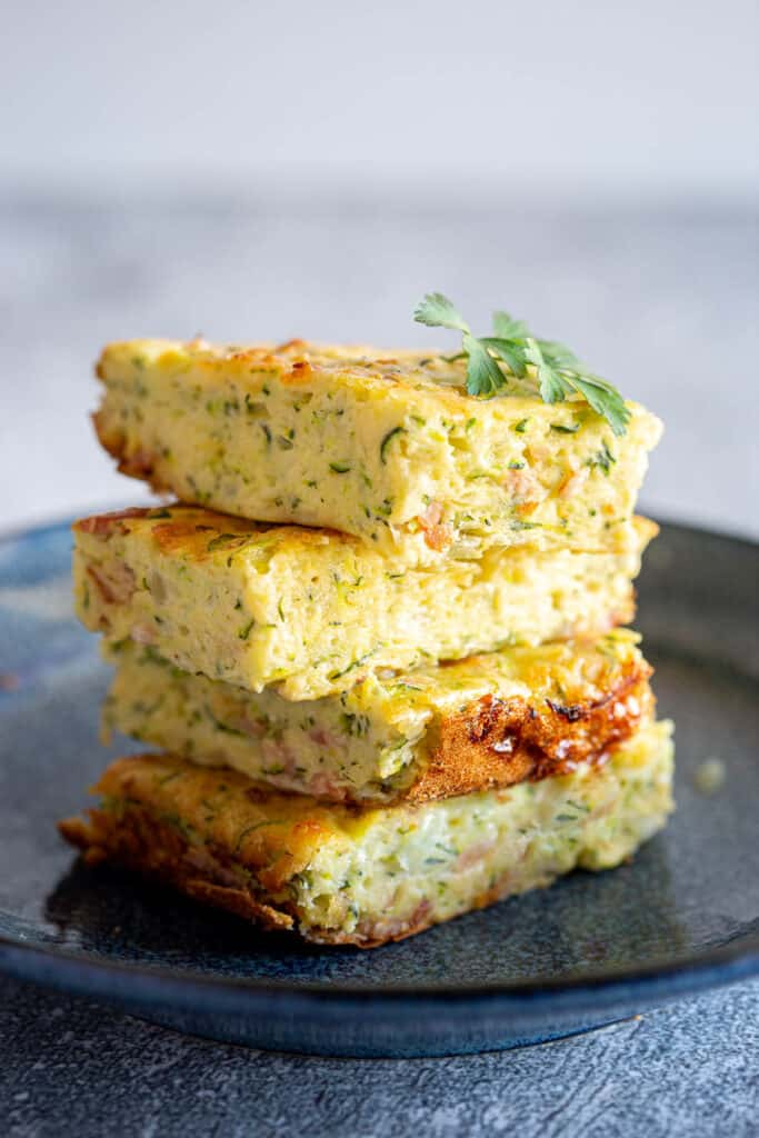 Four pieces of zucchini slice stacked on top of each other.