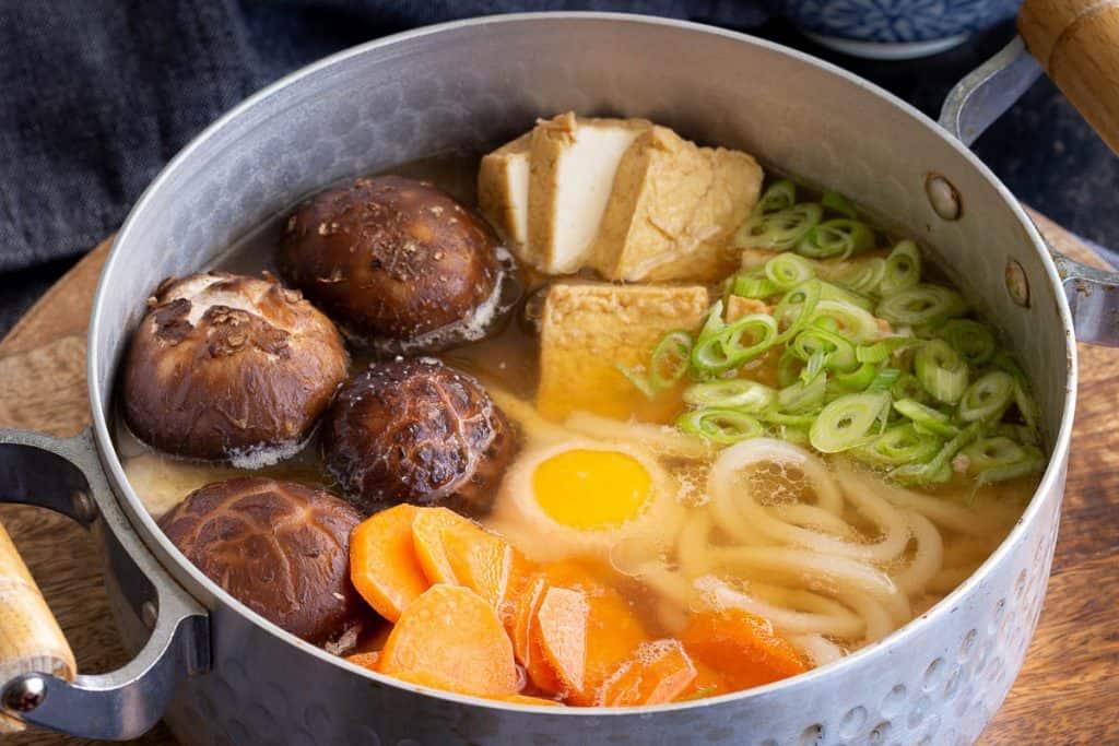 A bowl of nikomi udon soup with miso paste.