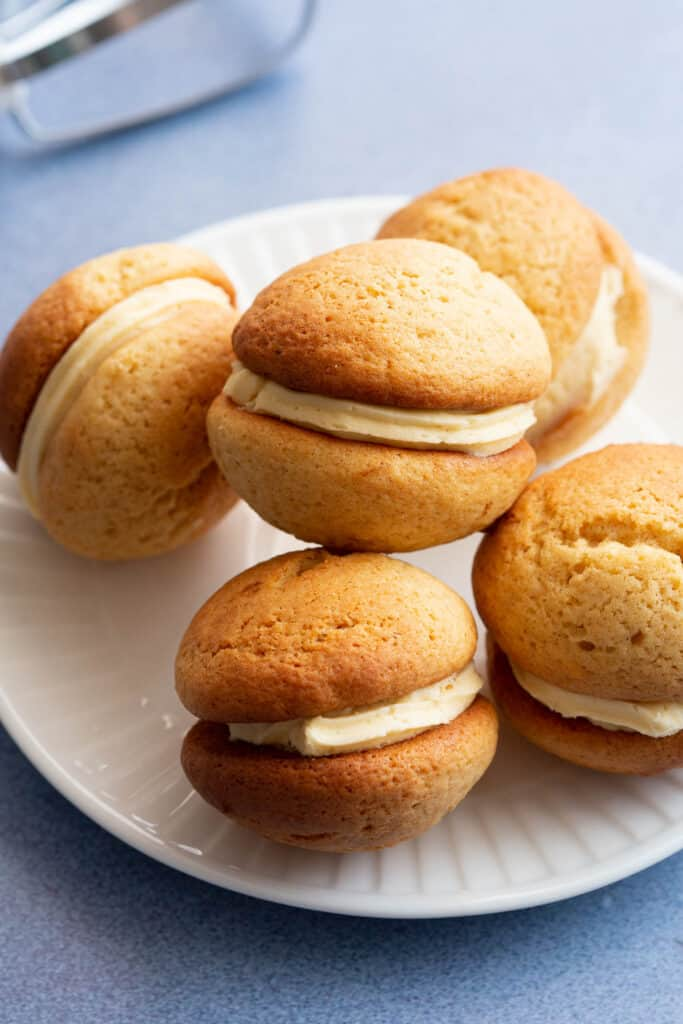 Small white plate stacked with five ginger kisses biscuits.