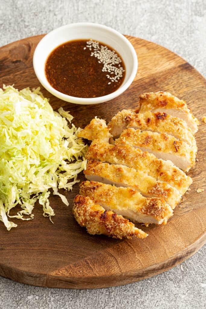 Japanese chicken katsu with cabbage and tonkatsu sauce.