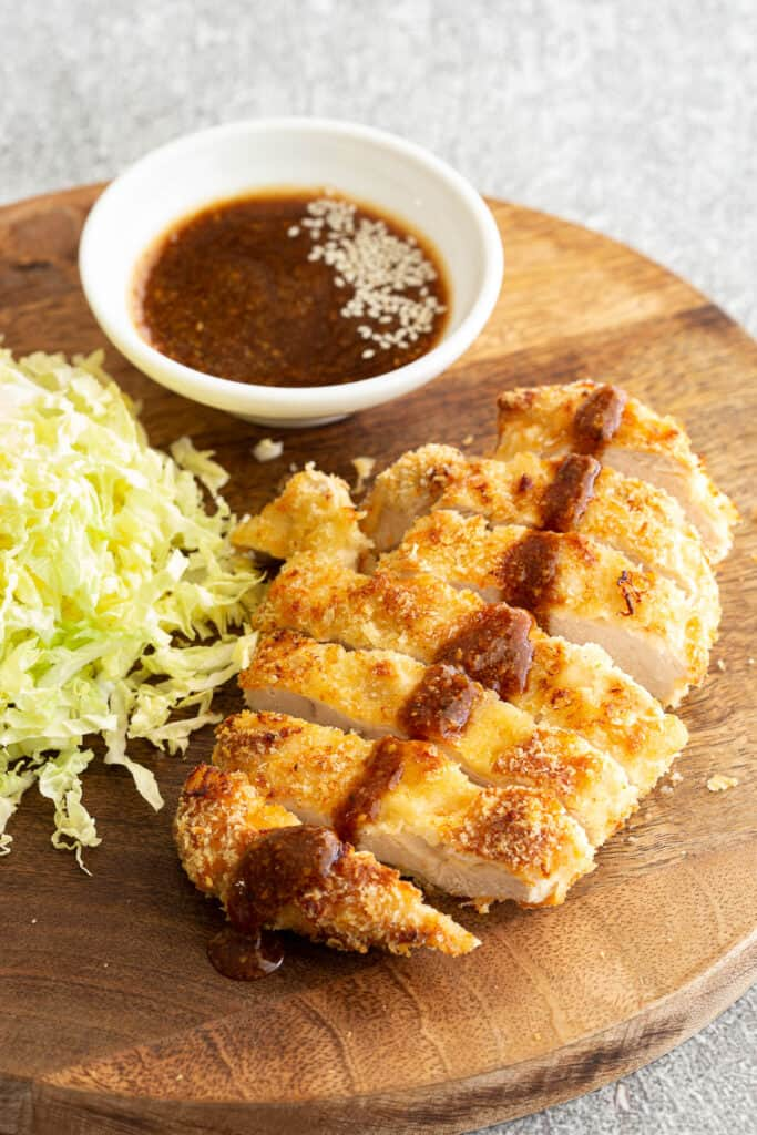 Chicken katsu piece with sauce poured over the top.