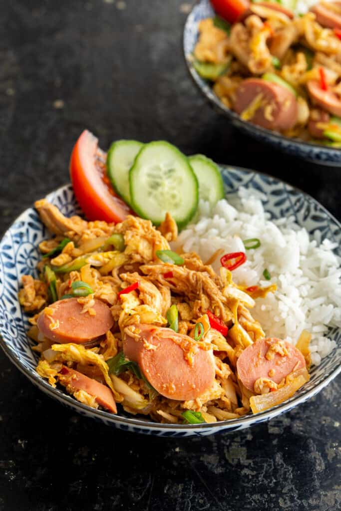Large bowl of Indonesian crazy rice with sausage.