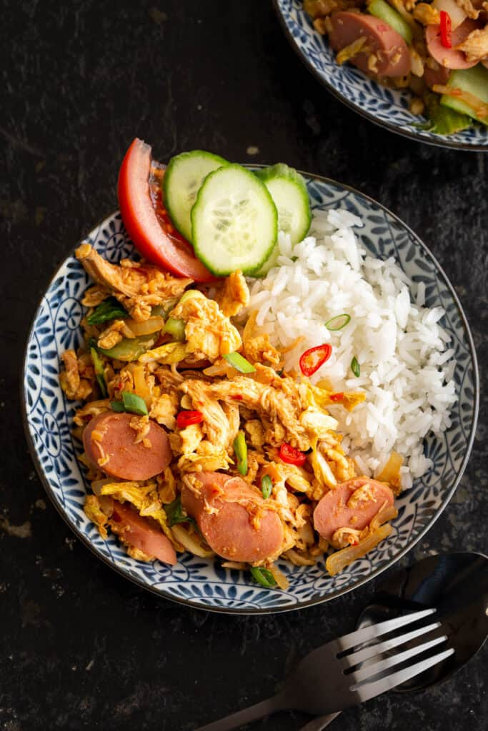 Sausage, egg and chicken Nasi Gila in large bowls.