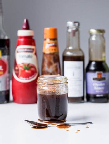 Jar of homemade Japanese sauce with bottles in background.