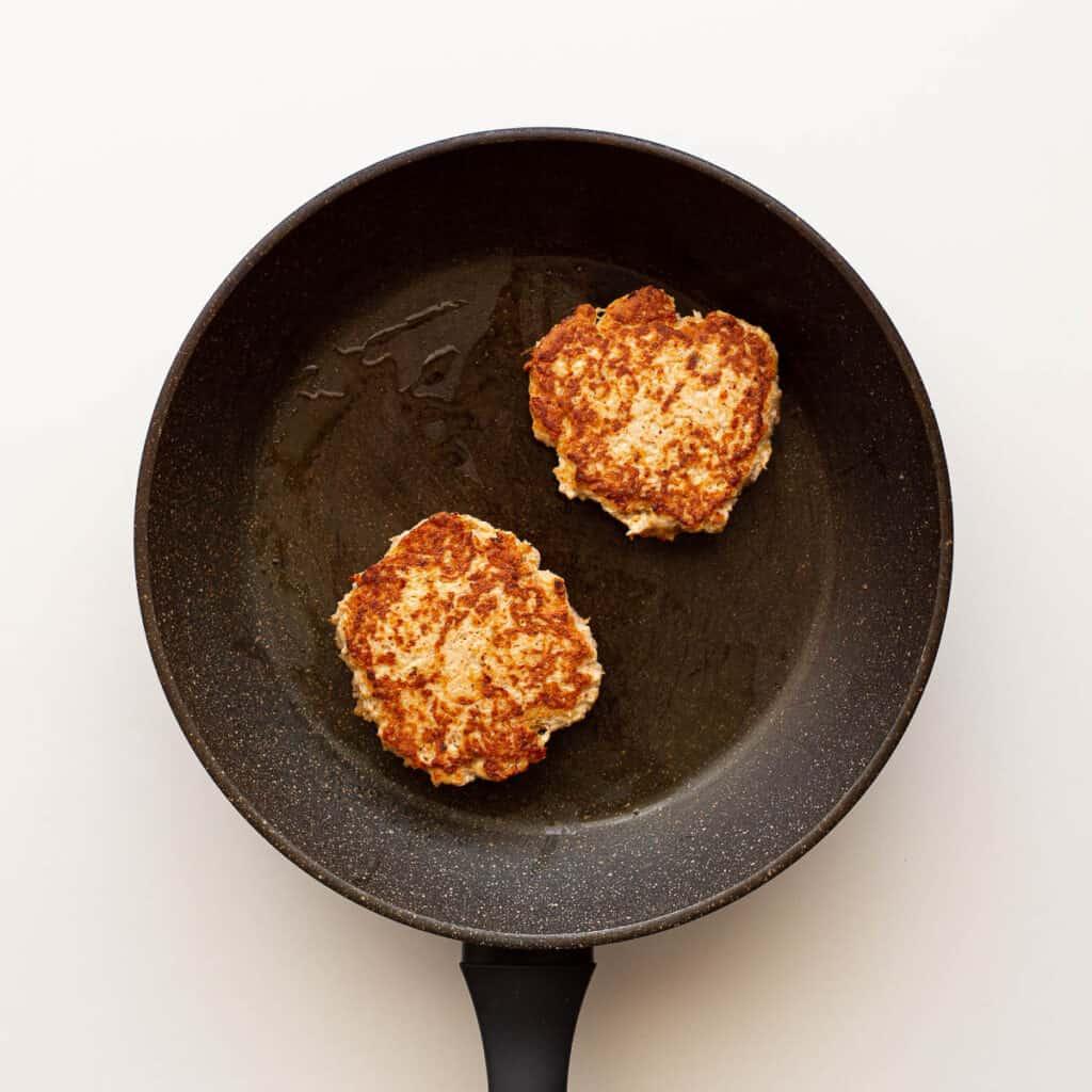Frying chicken patties.