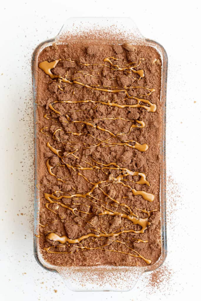 Top of a speculoos tiramisu with a biscoff spread drizzle on top.