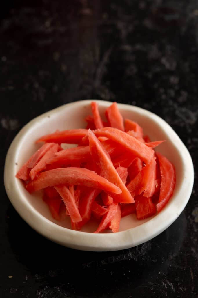 Small dish of freshly pickled red ginger.